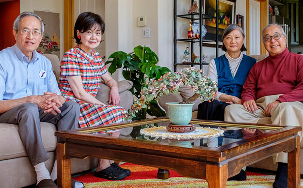 Wu and his wife, Hing, sit with the Lees in Wu s home in Bellingham, Washington